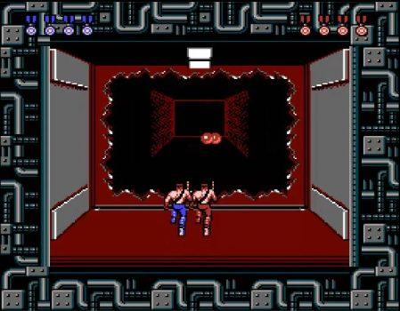 Contra - Ação cooperativa, alienígenas bizarros e heróis bombados no Nintendo 8 bits. Contra-dois-jogadores2-jogoveio-449x350